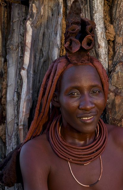 Africa | The chief's wife with fabulous head decoration. Namibia |  © Tim Thornton.