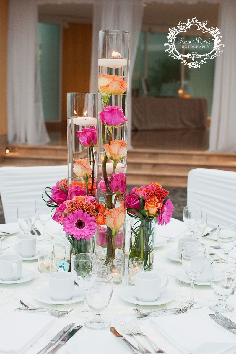Pink and orange wedding centerpiece with floating candles