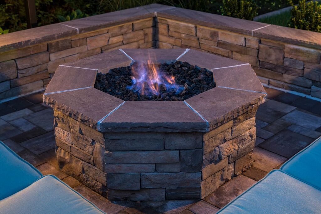 A Cambridge Pavingstones fire pit can be used throughout the year and is exactly what you need to warm up on a chilly day.  Contractor: Harborwood