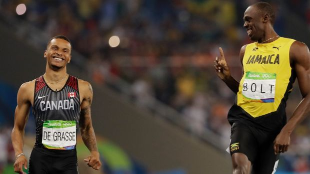 Usain Bolt wags his finger at Andre de Grasse after the men's 200-metre semifinal.