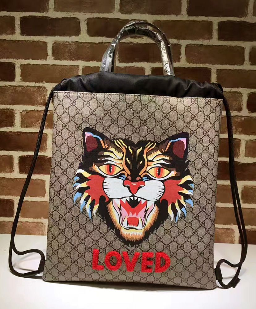 d37fc59331cf Gucci Angry Cat Print Soft GG Supreme Drawstring Backpack 473872 Coffee