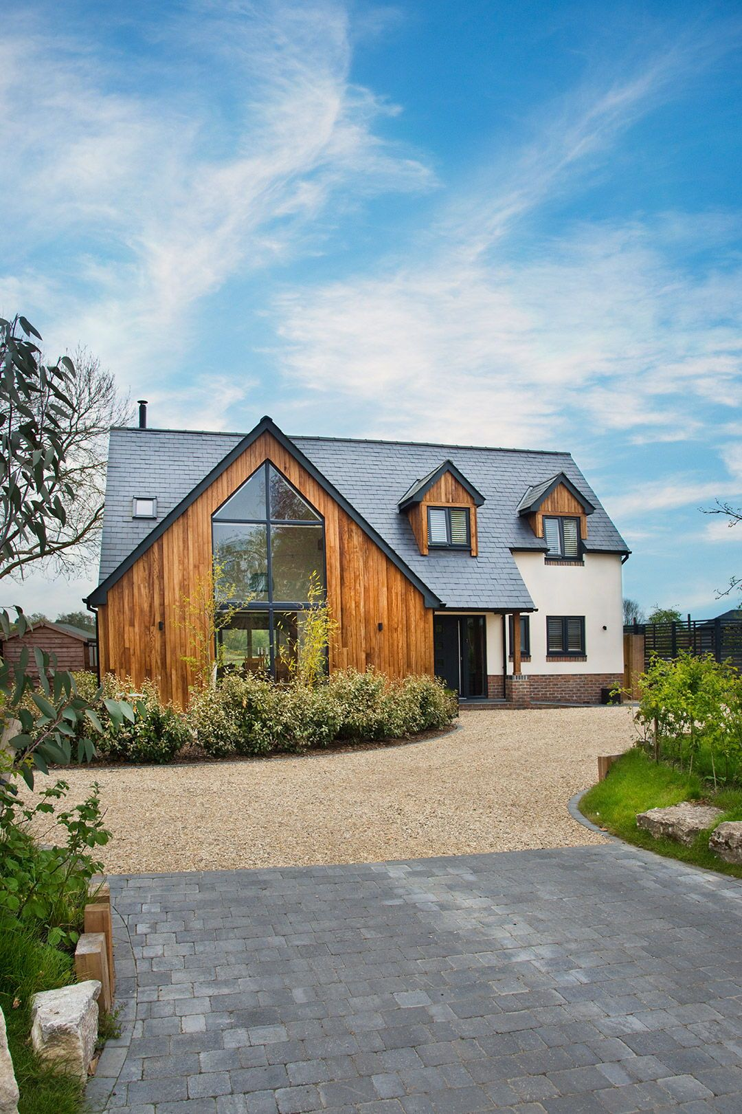 Budget House Builds. This Potton Home was built for £295,000. Its a modern cottage with white render and timber cladding. Read Dennis & Maureen Stephens full self-build story here ... #budgetbuild #pottonhome #timberframe #timbercladding #buildingahouse #costofbuildingahouse #dreamhouses