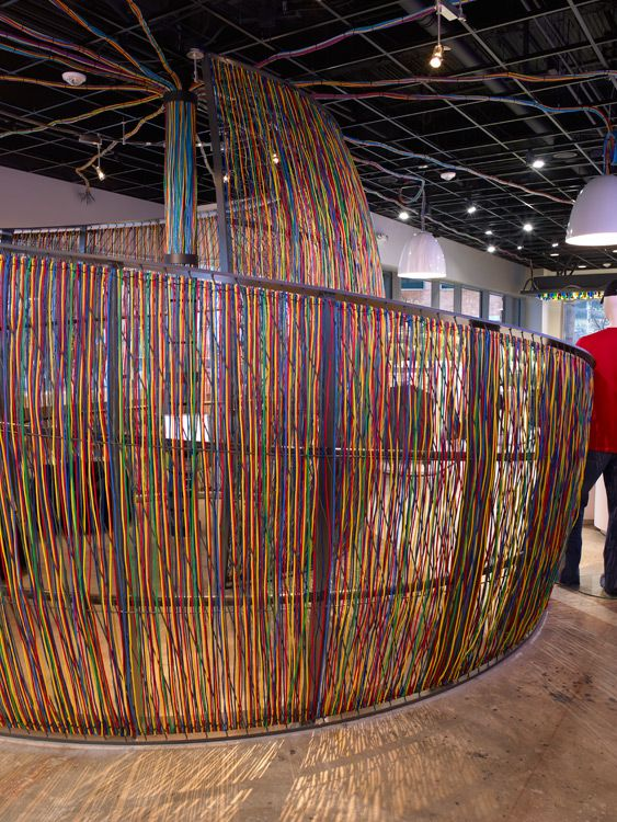 Large Technology Company Retail Store  Hand-woven CAT-5 cables wrapped over a custom-welded steel frame envelope the cocoon.