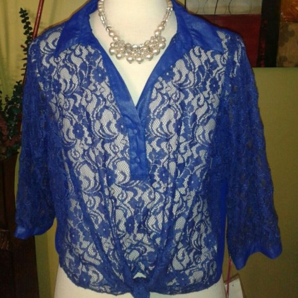 ROYAL BLUE LACE FRONT BLOUSE Sheer lace front with two button on the vneck line and full fabric back .  Both sleeves are three quarter lenght lace with button accent.  This elegant blouse is topped off with a waistline front tie in a bow or knot.  The collar is fabric like the back. Tattoo Me Tops Blouses