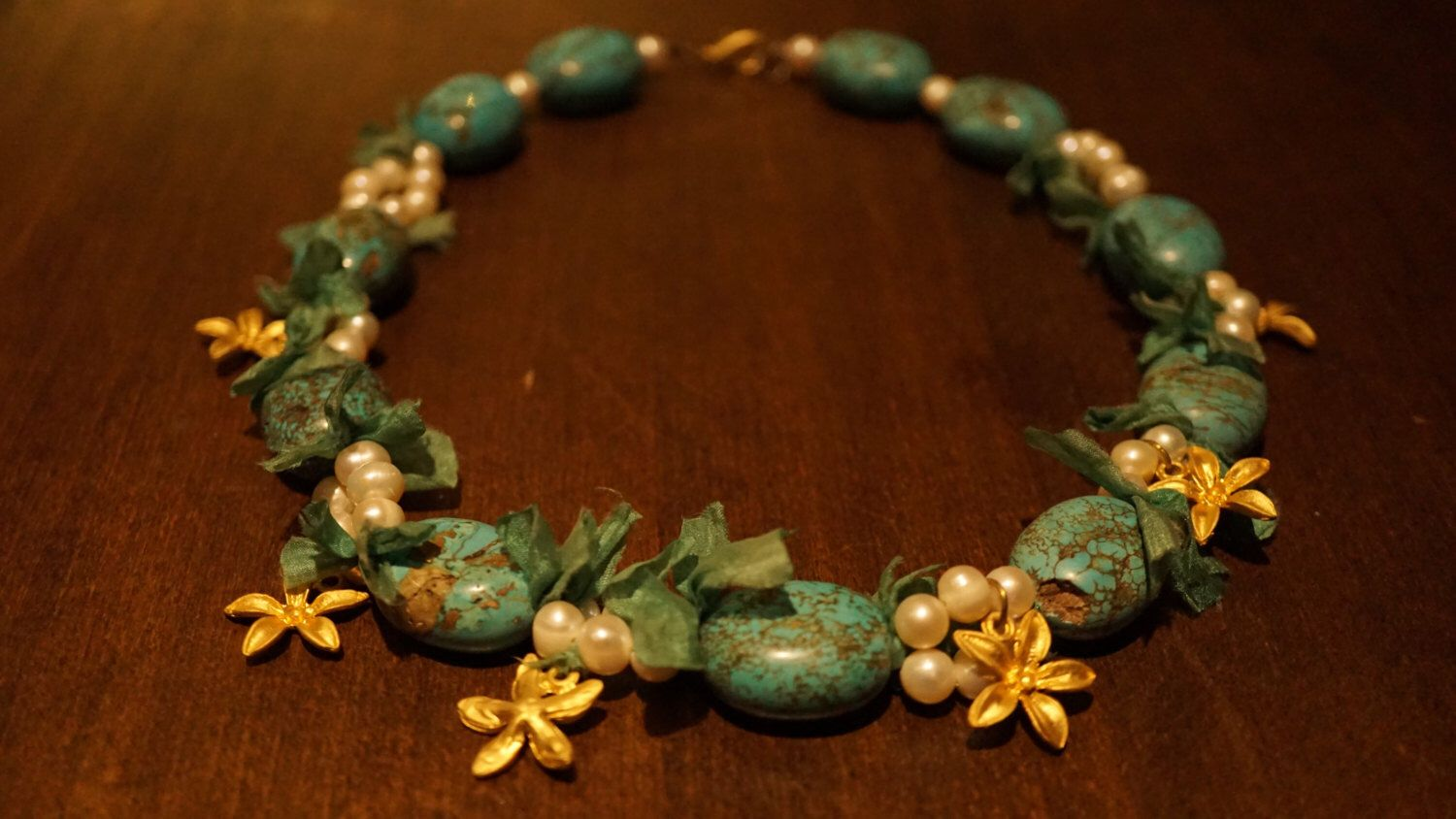 A personal favorite from my Etsy shop https://www.etsy.com/listing/466230641/turquoise-pearl-necklace-with-silk-and