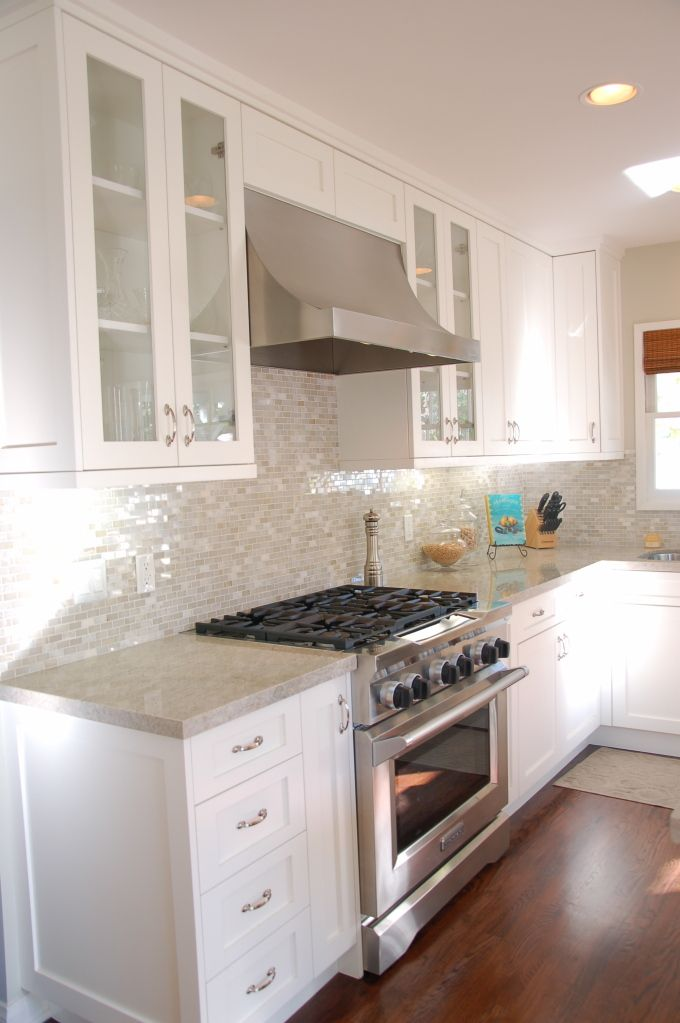 """kitchen with nice vent hood,** I hate microwaves above because the airflow """"sucks"""".** dark floors on white and light grey..... I would make the floors darker."""