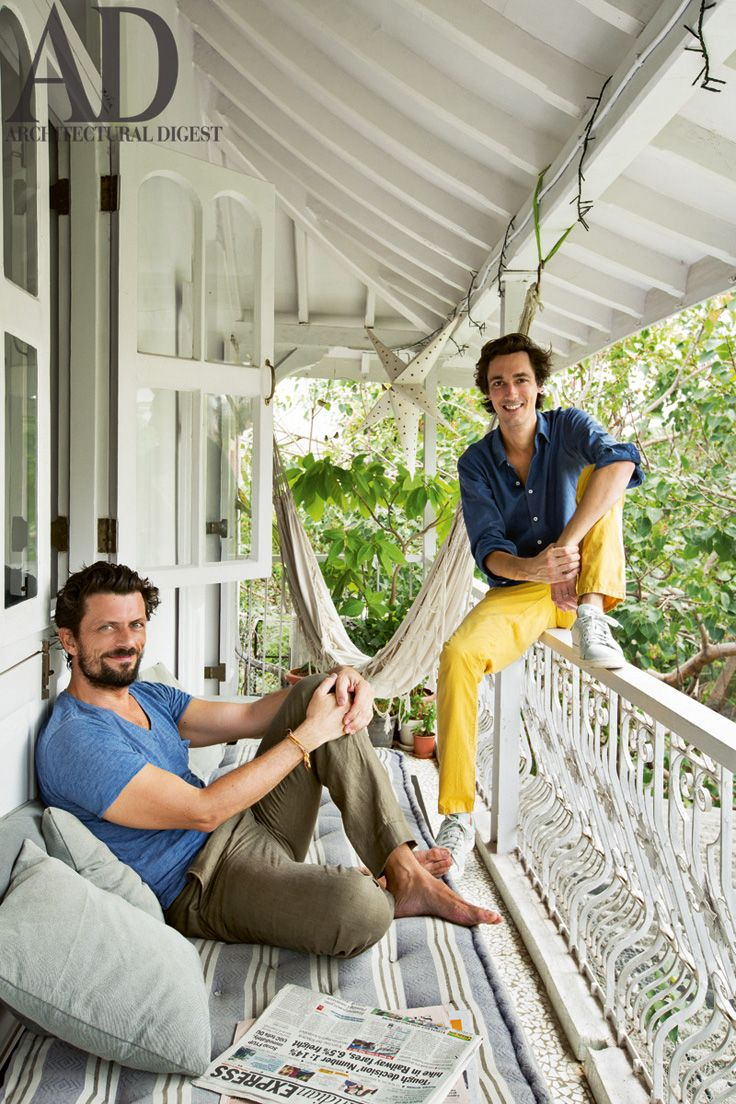 Constantin Le Blan and Guillaume Delacroix in the #balcony of their #Mumbai #home. #White, #Wrought #iron #railing, #Mattress, #Hammock. Photographer: Ricardo Labougle