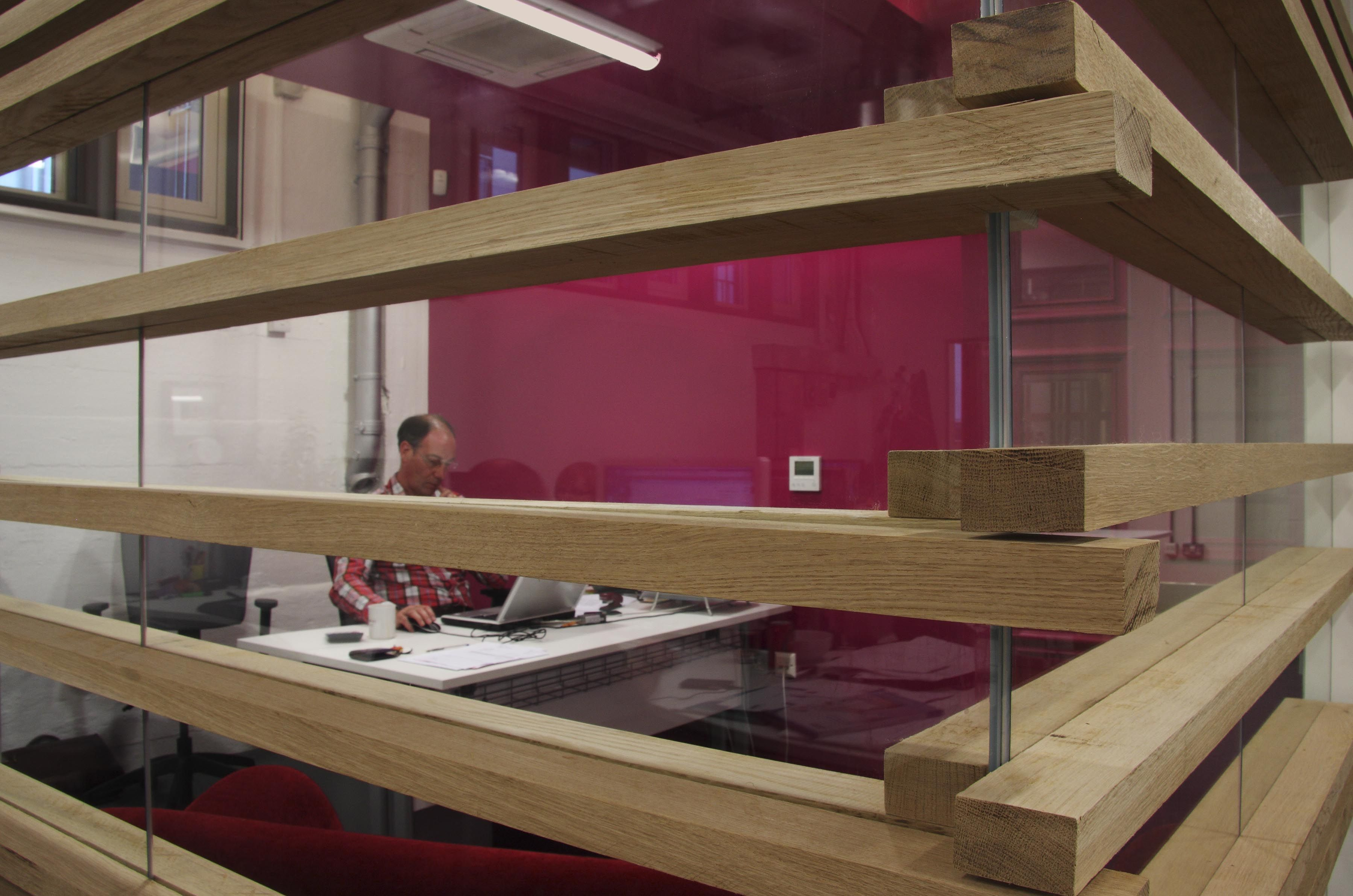Highlighting the wooden slats and glass partitioning in more detail. Copyright: Workplace Creations Ltd.