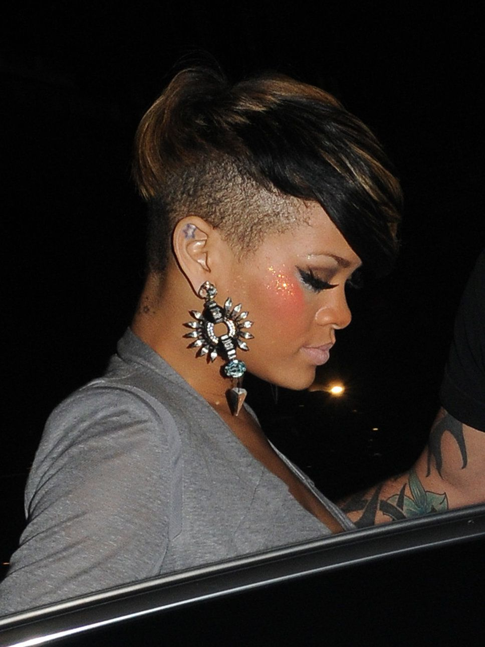 fro hawk hairstyles for afro women 2014 | Rihanna grey top shoulder pads earrings hairstyle faux hawk