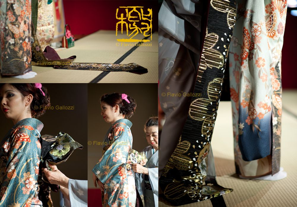 The art of wearing kimono. Master Hoashi Tomoko and her daughter Erica during the kimono dressing show. Photo © Flavio Gallozzi - All rights reserved