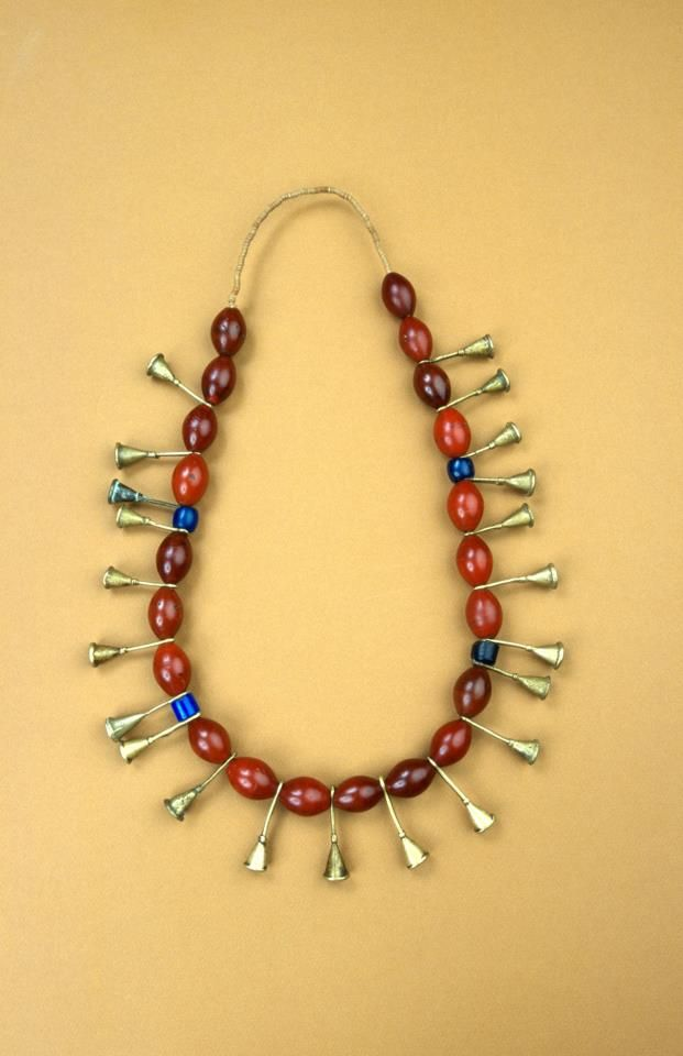 Necklace of imitation carnelian beads alternating with brass trumpet-shaped beads. Nagaland: Ao Naga people; mid 20th c.