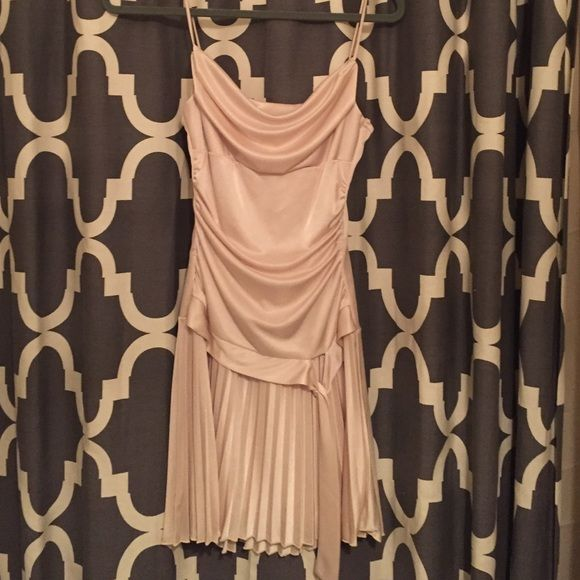 Adorable champagne colored dress Adorable  champagne colored dress . MIDI . Wore on a cruise once . Light weight tight up top and flows on the Bottom . Would be perfect for a school dance , wedding or just a nice dinner Dresses Midi
