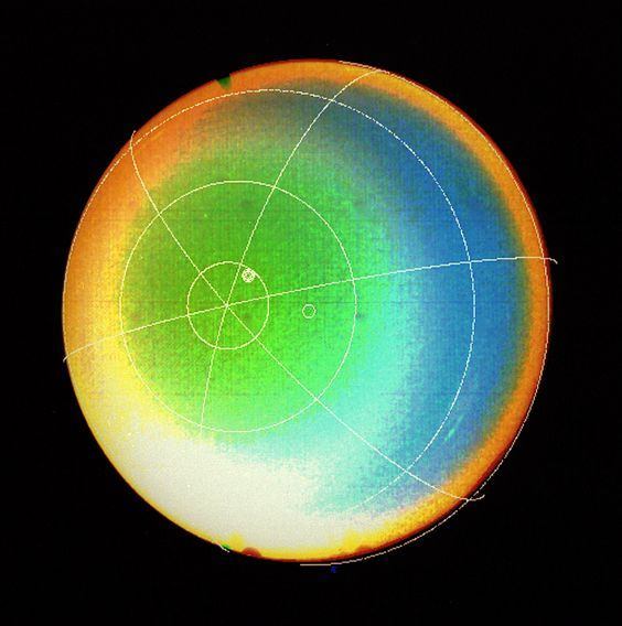 Uranus' Atmosphere  A latitude-longitude grid superimposed on this Voyager 2 false color image shows that Uranus' atmosphere circulates in the same direction as the planet rotates.  Image #: PIA01489 Date: January 24, 1986