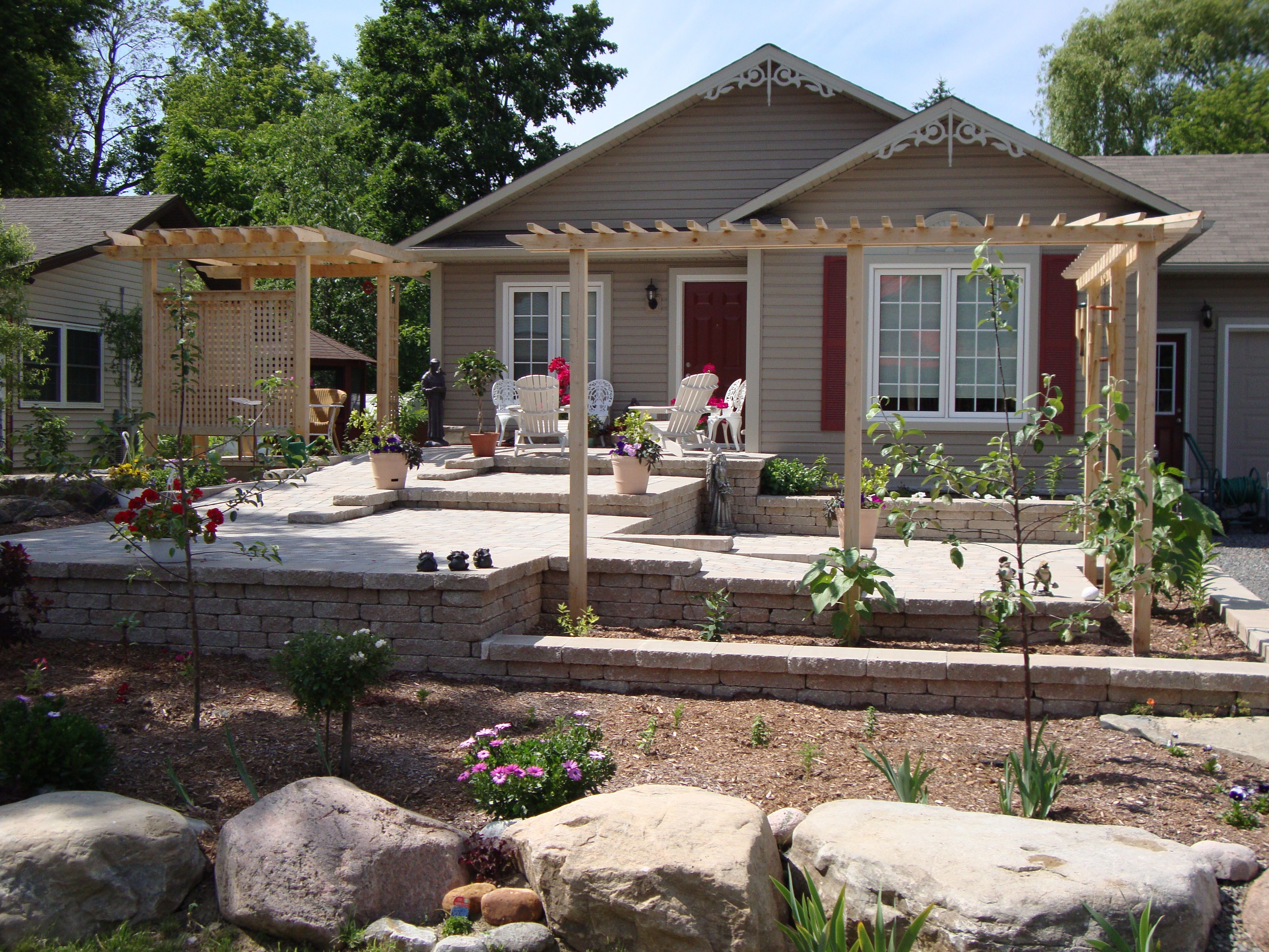 accessible ramped interlock front entry with gardens installed