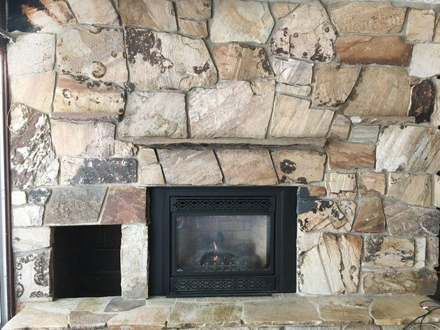How To Update A Rock Fireplace By Using Paint Ehow Rock Fireplaces Painted Rock Fireplaces Lava Rock Fireplace
