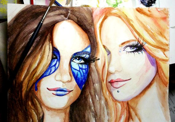 Capitol Citizens of Panem - Hunger Games artwork: two lovely ladies decked out with pretty punk makeup!