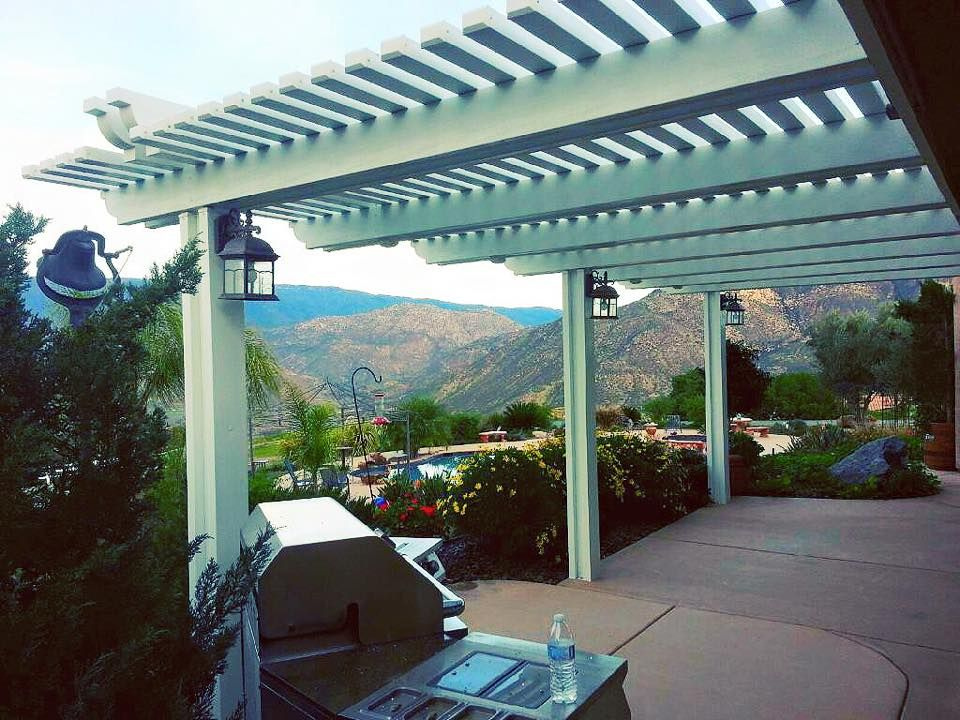 alumawood lattice patio cover in white with reverse header beams