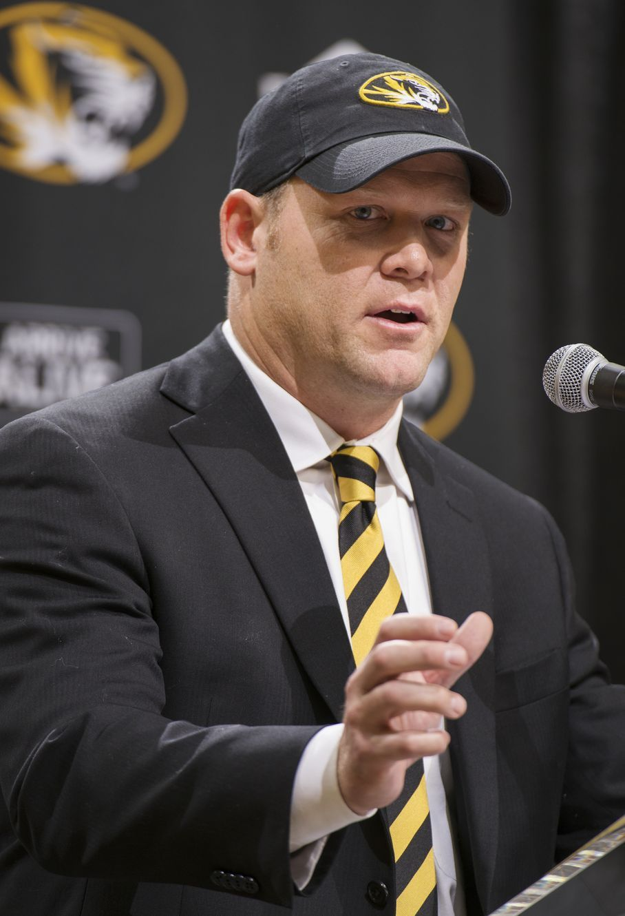 Barry Odom talks to a crowd gathered at Mizzou Arena as he