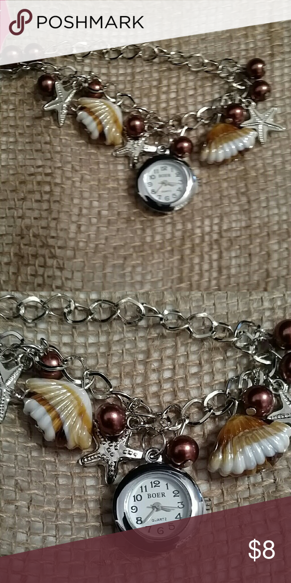 Watch Silver bracelet watch, with shell and starfish accents Accessories Watches