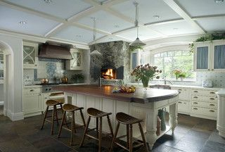 This kitchen looks so bright and yet cozy. It has a fireplace!