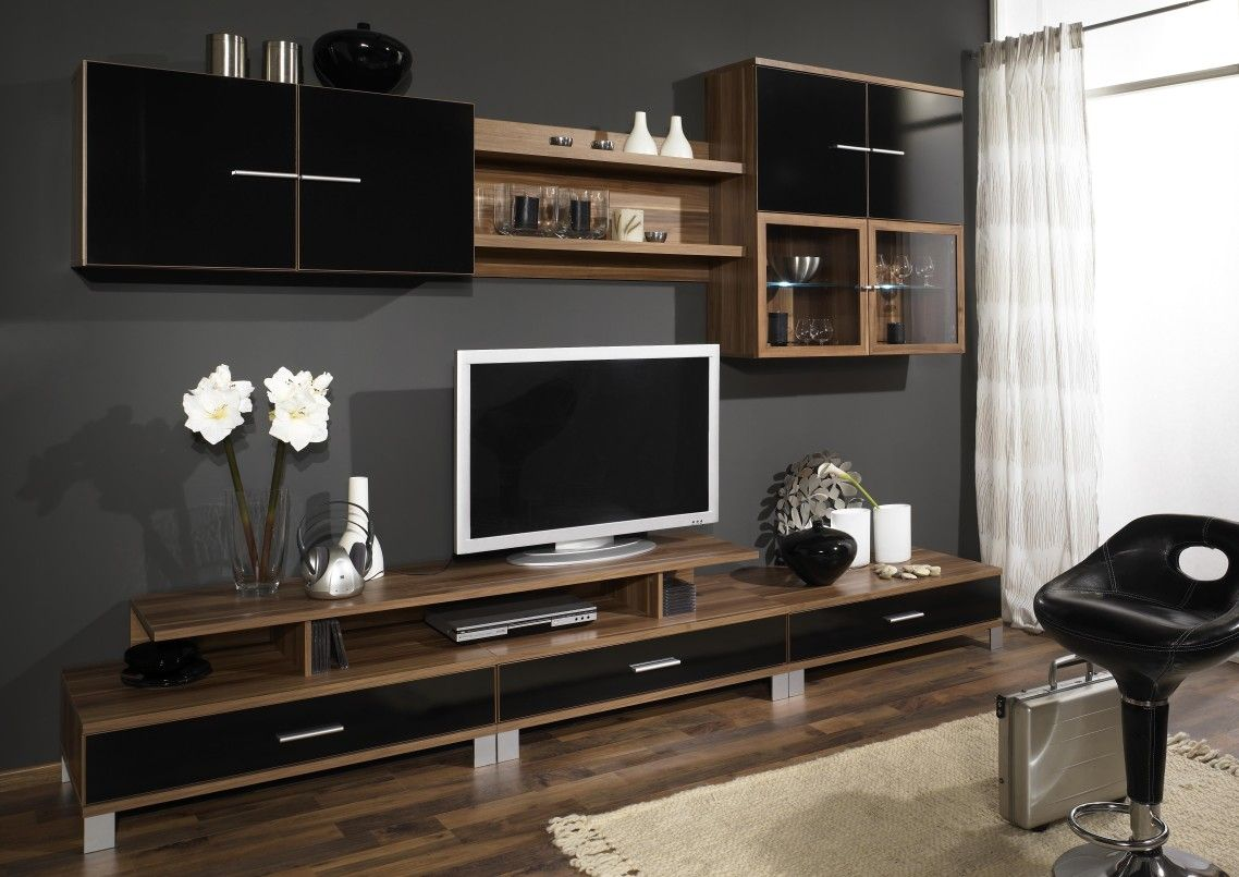 Seductive Tv Wall Unit Design On The Brown Wooden Cupboard