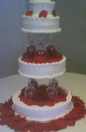 3 Tiers Floating On Wine Glasses Wedding Cake By EJs Sweets
