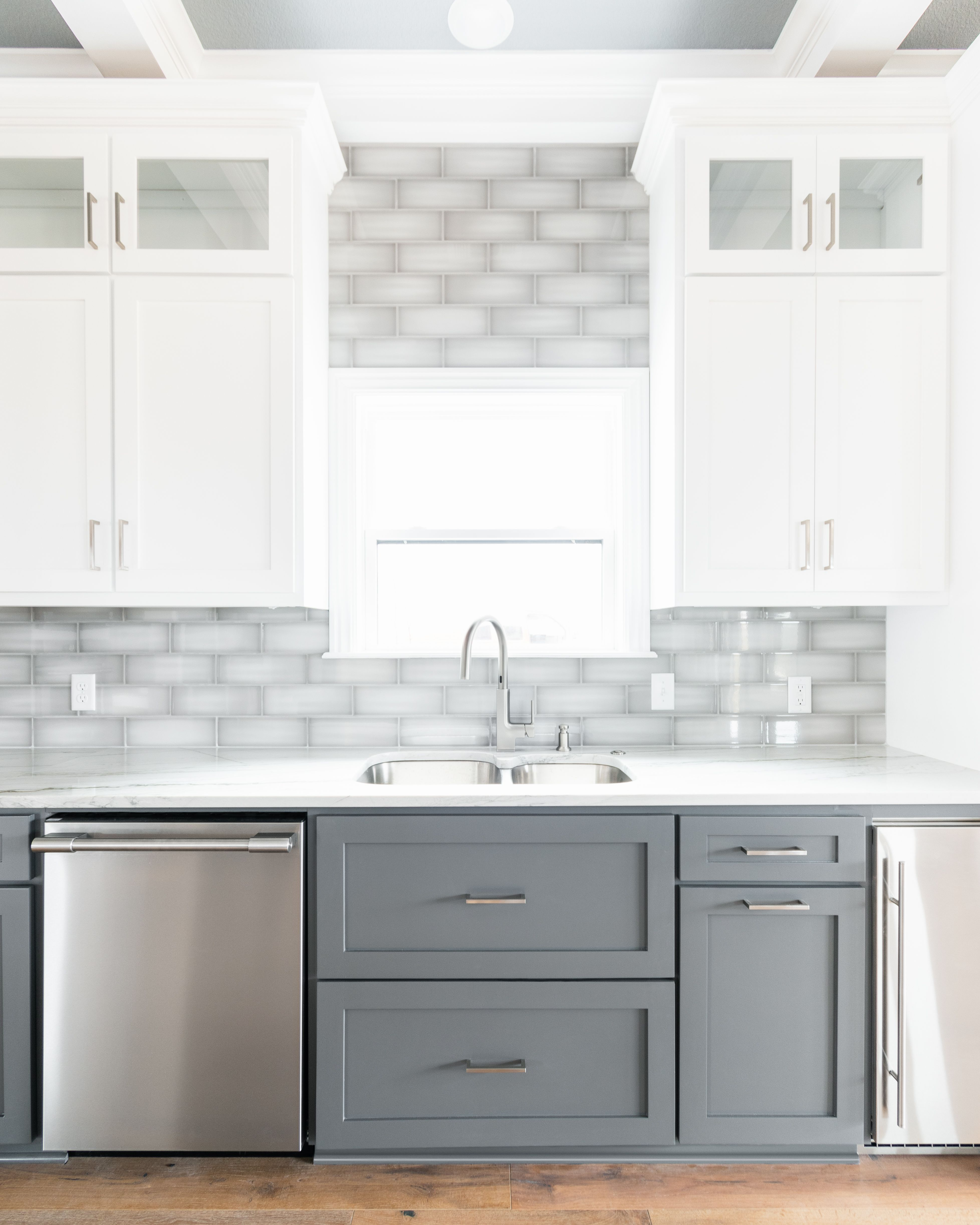 Gorgeous Two Tone White Upper And Dark Gray Lower Shaker Cabinets