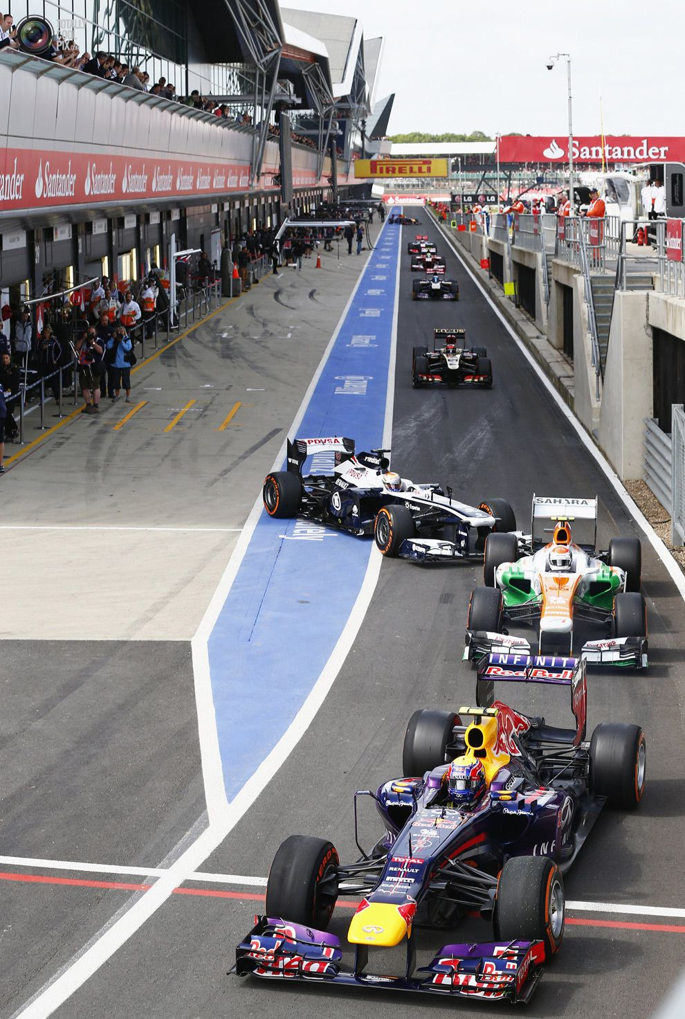 Red Bull Formula One driver Webber heads queue to leave pit lane ...