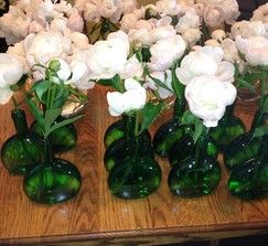 Vintage Green glass bottles, great for using as bud vases    10 available    $5 each, shipping tbd on qty and location  http://www.100layercake.com/market/view/3040/vintage-green-glass-bottles/