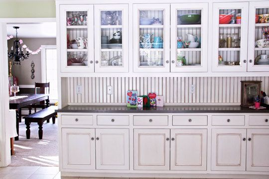 Gorgeous glass-front cabinets via Apartment Therapy awesome alternative to open shelving in the kitchen