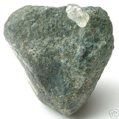 Kimberlite rock, with uncut natural white rough diamonds ...