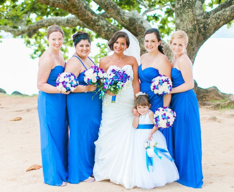 Pretty Royal Blue Bridesmaid Dresses And Blue Orchid Bouquets.