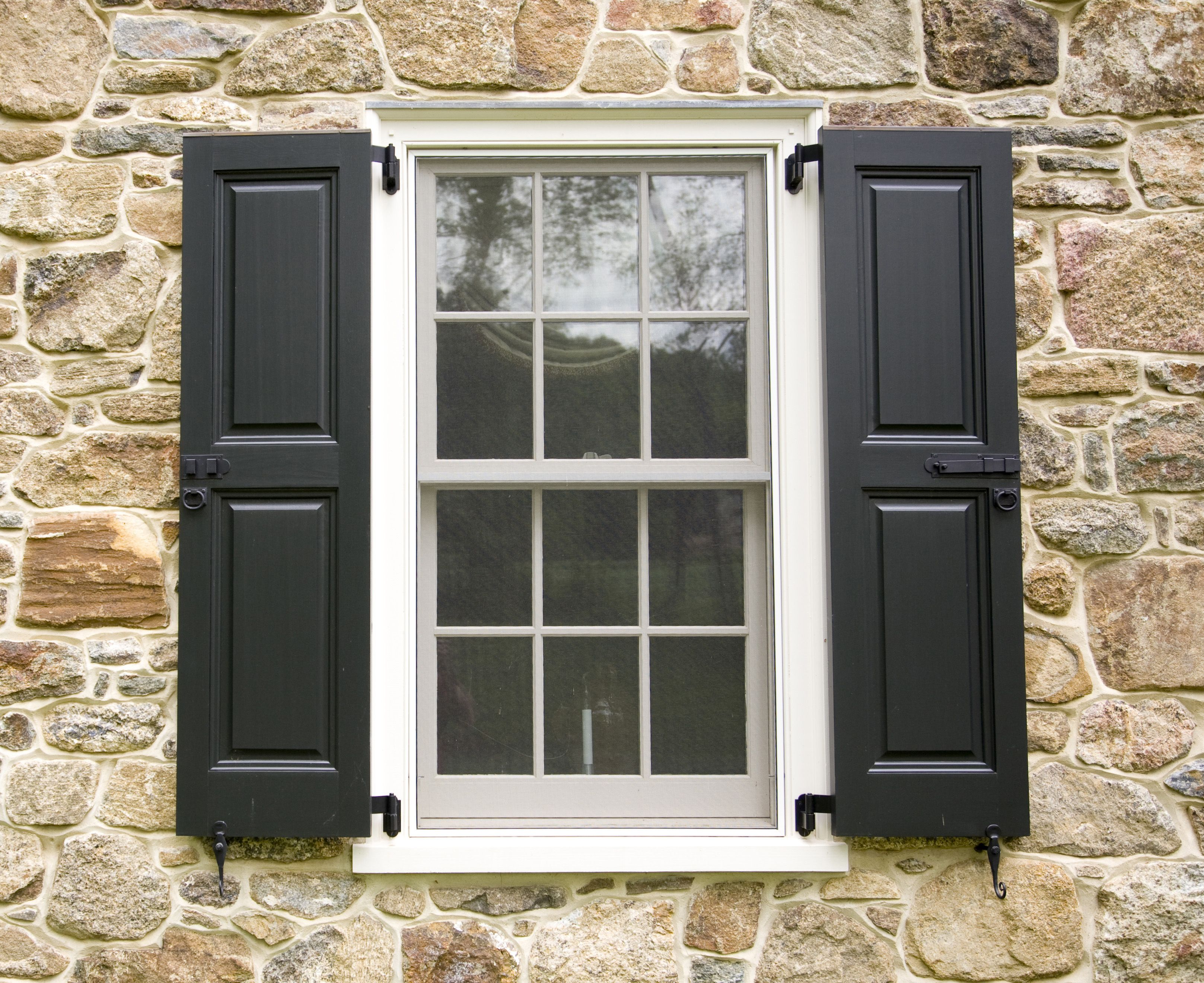 Exterior windows with shutters - Hurricane Shutters
