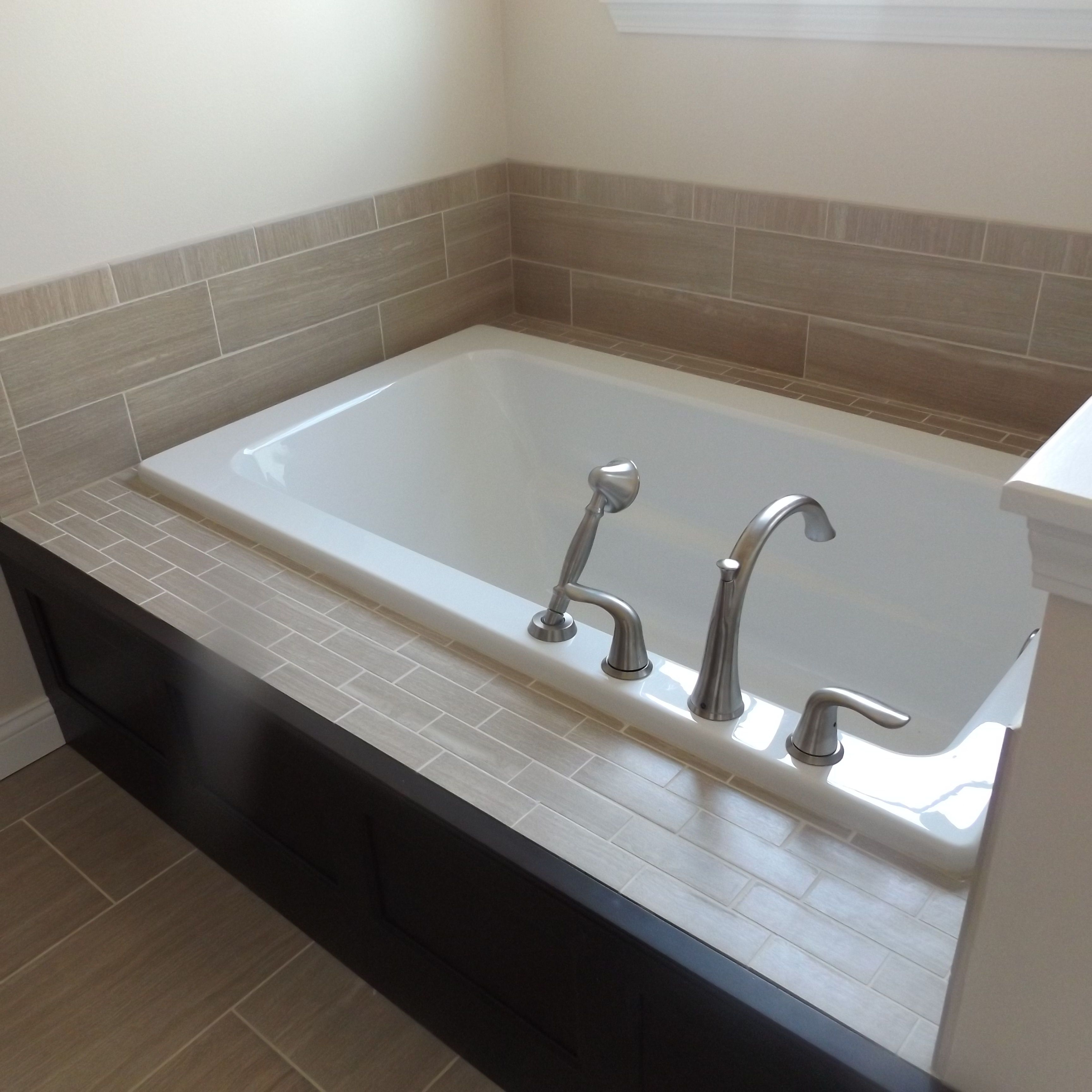 Relax in a large soaker tub with beautiful custom ceramic tile ...
