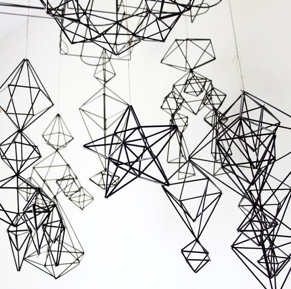 Hanging Triangular Structure Made Out Of Steel Music Wire