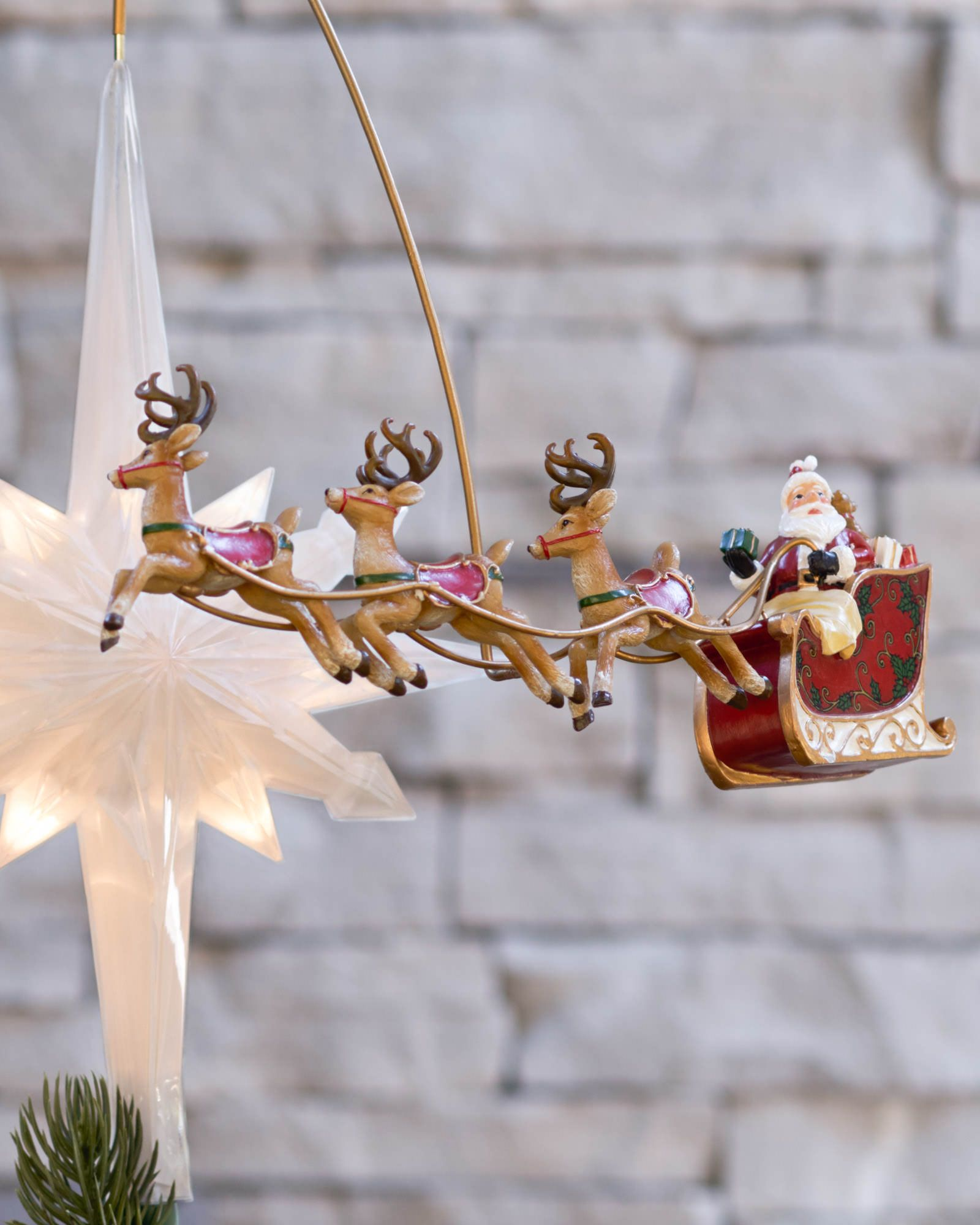 Sure to be adored by the young and young at heart, Santa's Sleigh Animated Christmas Tree Topper shows a Santa figurine upon his sleigh pulled by three reindeer, revolving around a bright yellow star. Get a chance to win this charming tree topper in our 12 Days Of Giveaways. gleam.io/fb/yseJA