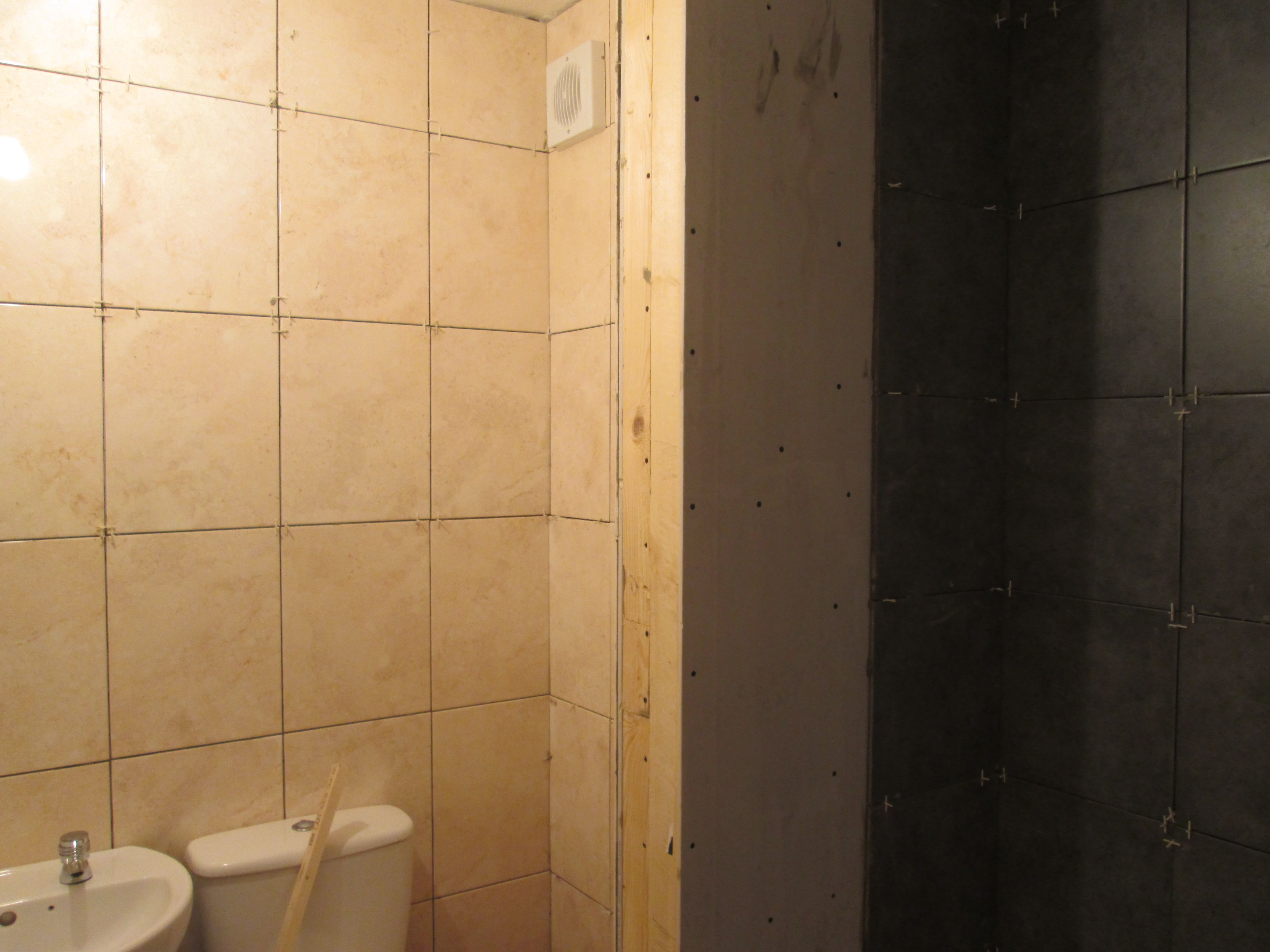 Shower cubicle to the right with main bathroom on the left.