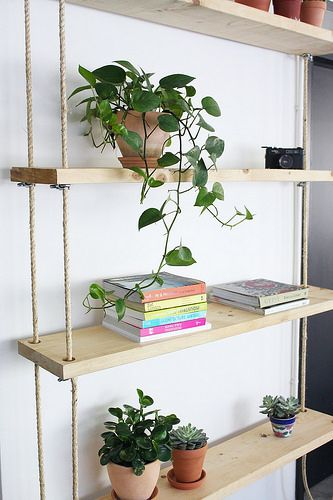 Diy Hanging Rope Shelves Collective Gen Hanging Rope Shelves Hanging Bookshelves Rope Shelves