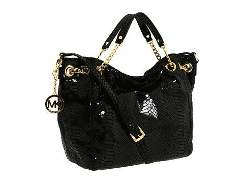 This sensational MICHAEL Michael Kors shoulder tote will satisfy any  seasoned socialite who scours the globe in style. Tote-style shoulder bag  made of ...
