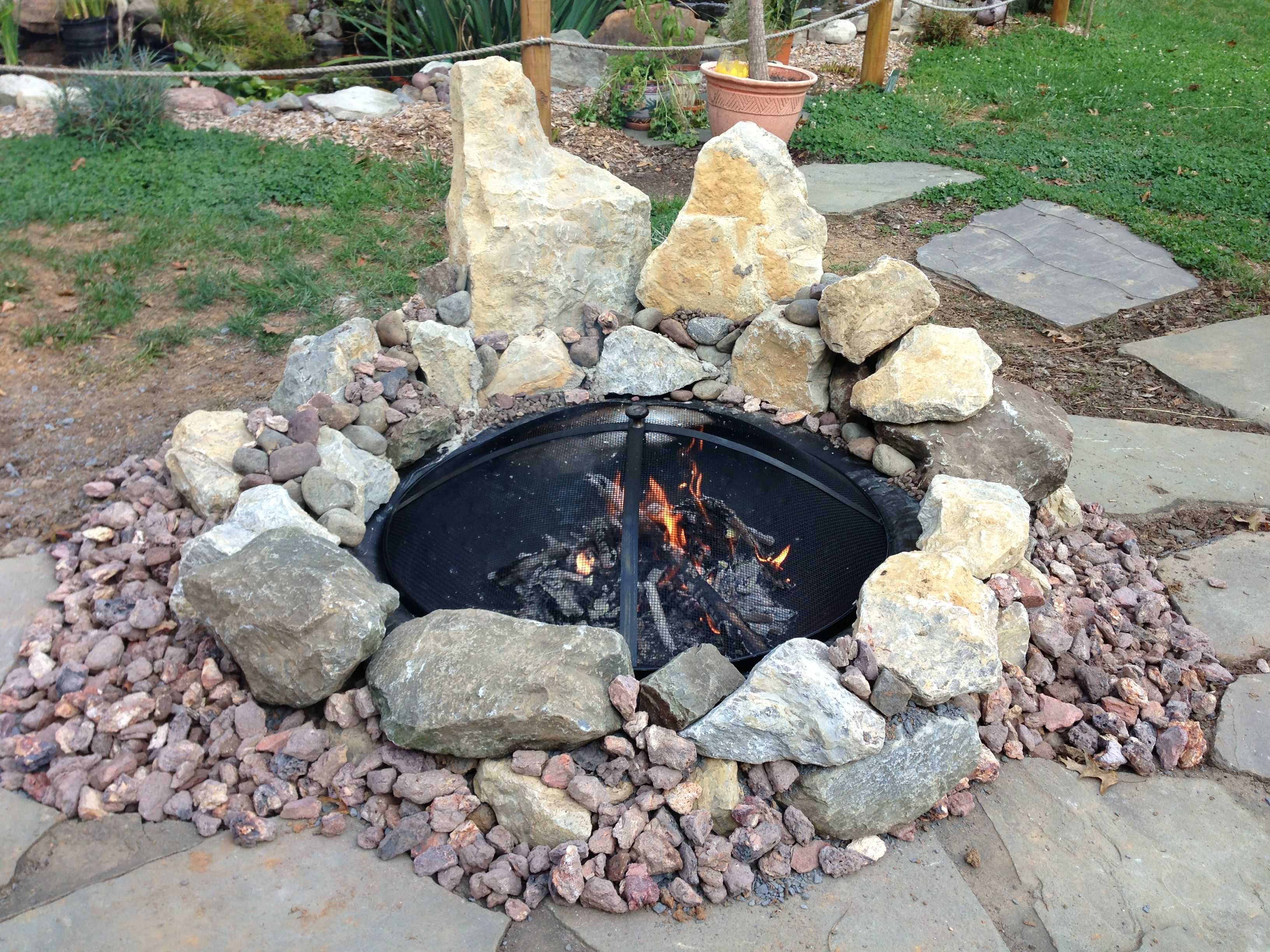 Backyard Fire Pit Made From Free Stones Found On The Roadside Bring Them Home Then Go To Home Depot And Buy A 50 00 Fire Pit Liner Fire Pit Fire Pit Designs