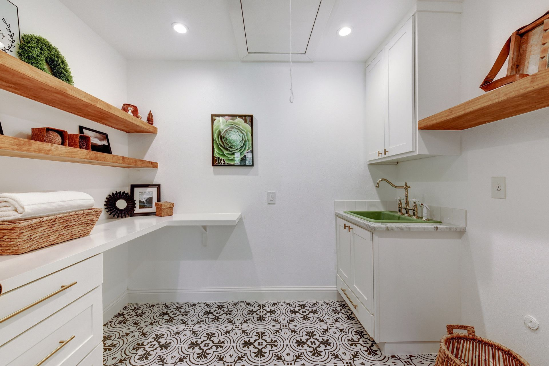 laundry room remodel with patterned tile floor open shelves vintage green sink brass
