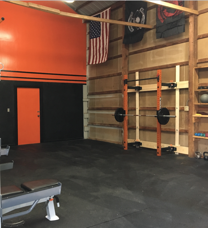 Orange is a great color for a garage gym wall but its even better