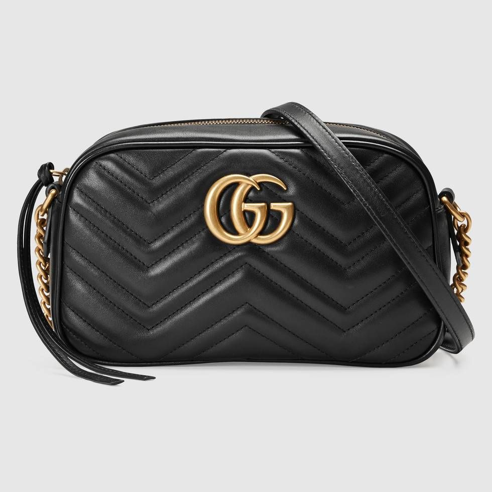 acc99b352535 Shop the GG Marmont small matelassé shoulder bag by Gucci. The small GG  Marmont chain shoulder bag has a softly structured shape and a zip top  closure with ...