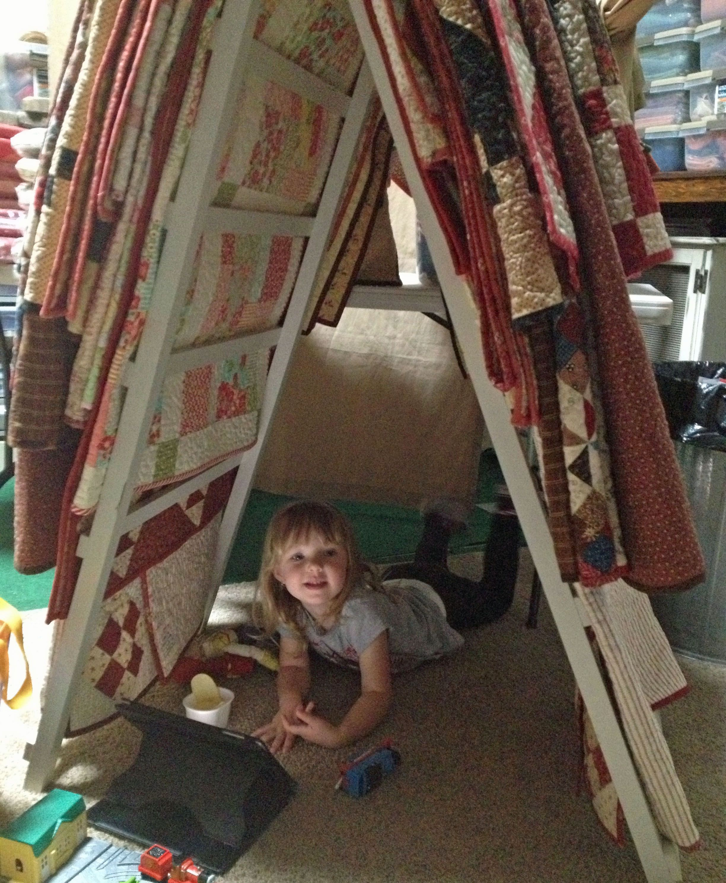 Addy's helping get the quilts ready for the warehouse sale! http://myreddoordesignsblog.blogspot.com