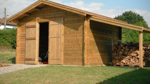 Un abri de jardin avec son appentis pour le bois Abris de jardin - Montage D Un Garage En Bois
