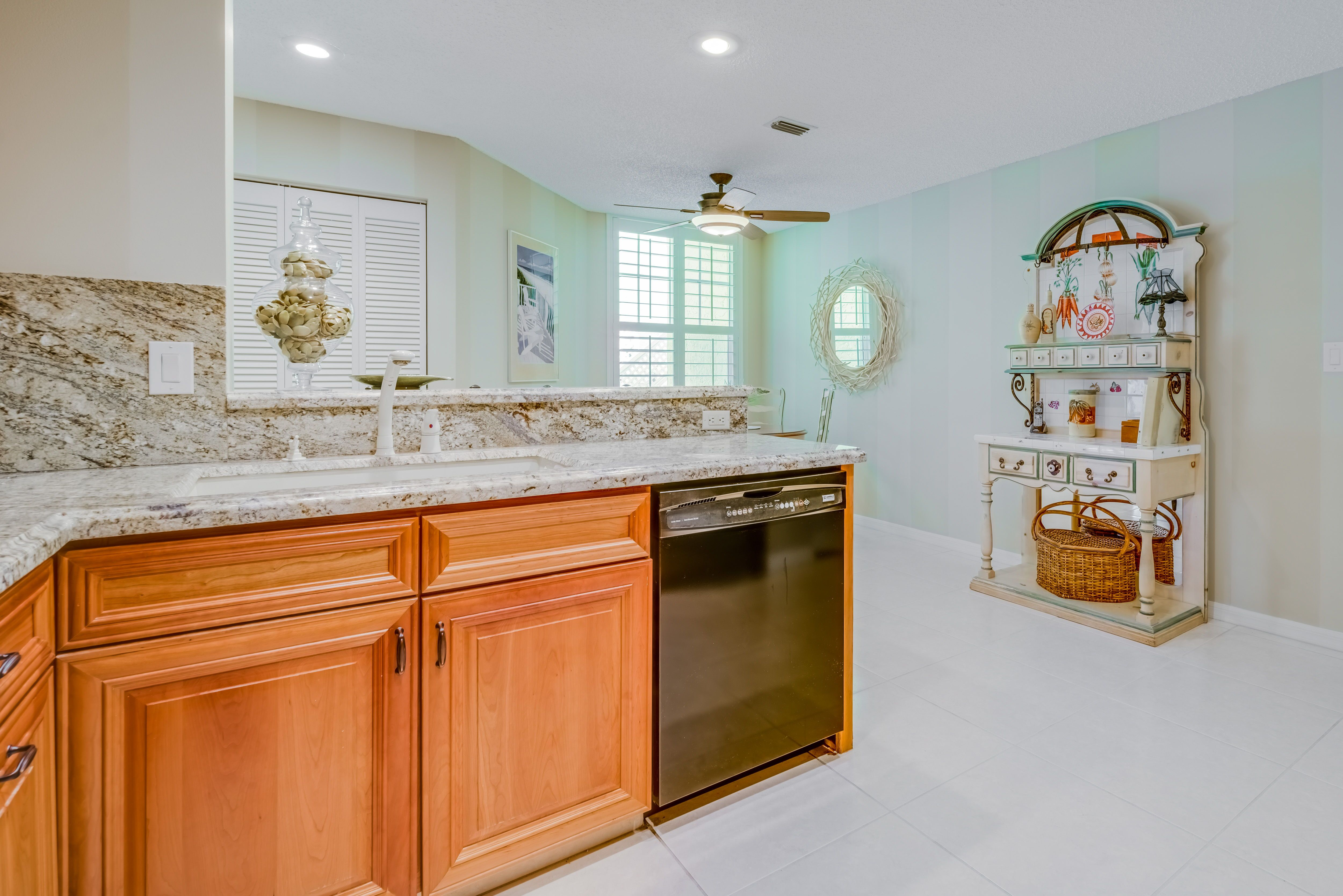 The kitchen has been updated with natural cherry cabinets highend