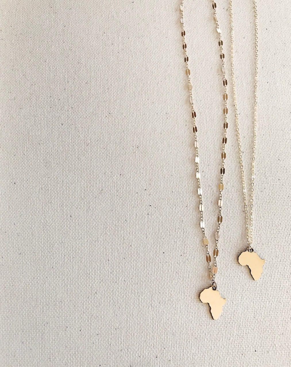 Photo of Small Africa Necklace – MELANIE MARiE
