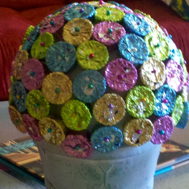 Candy centerpiece- very simple all you need is a styrofoam sphere (the size depends how big you want to make it), a decorative pot, colored pins and Reese's peanut buttercups in foil. Place sphere in pot then pin Peanut buttercups alternating colors. Makes a cute centerpiece and people can pick off the candy for dessert:)