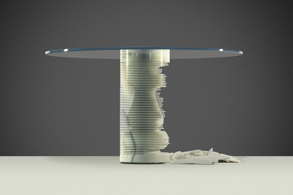 "'Introverso' is a table with two souls, that can be modern or classic, according to the choice of those who own it .   You can decide to keep the original cylindrical shape of the leg (modern) or transform it by using a hammer to ""break"" the thin marble plates forming it in order to stand out the shape of a turned (classic) leg hidden inside."