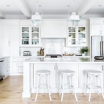 White Cottage Kitchen Island With White French Backless Bar Stools